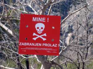 Landmine caution signs in hazardous areas.